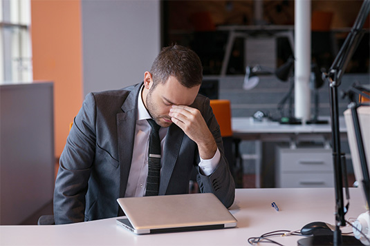 overwhelmed person working